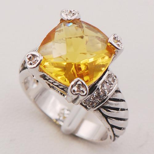 Стильные магические серебряные кольца с цитрином